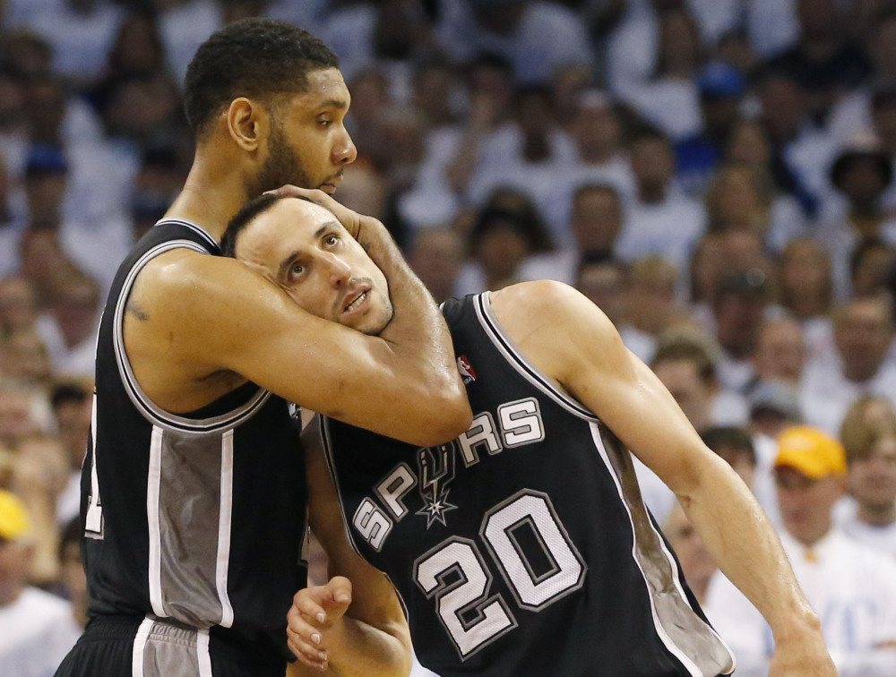 San Antonio Spurs forward Tim Duncan, left, and Manu Ginobili celebrate after Ginobili hit a 3-point basket in the final minutes against the Oklahoma City Thunder in the second half of Game 6 of the Western Conference finals NBA basketball playoff series in Oklahoma City, Saturday, May 31, 2014. (AP Photo/Sue Ogrocki) ORG XMIT: TXKJ152